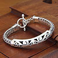 Sterling silver braided bracelet, 'Mystic Symbols'