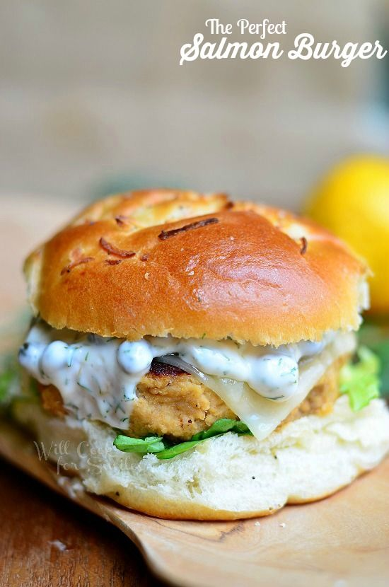 The Perfect Salmon Burger. Delicious salmon patty served on an onion roll, with picked, cheese and topped with caper dill sauce!! willcookforsmiles.com