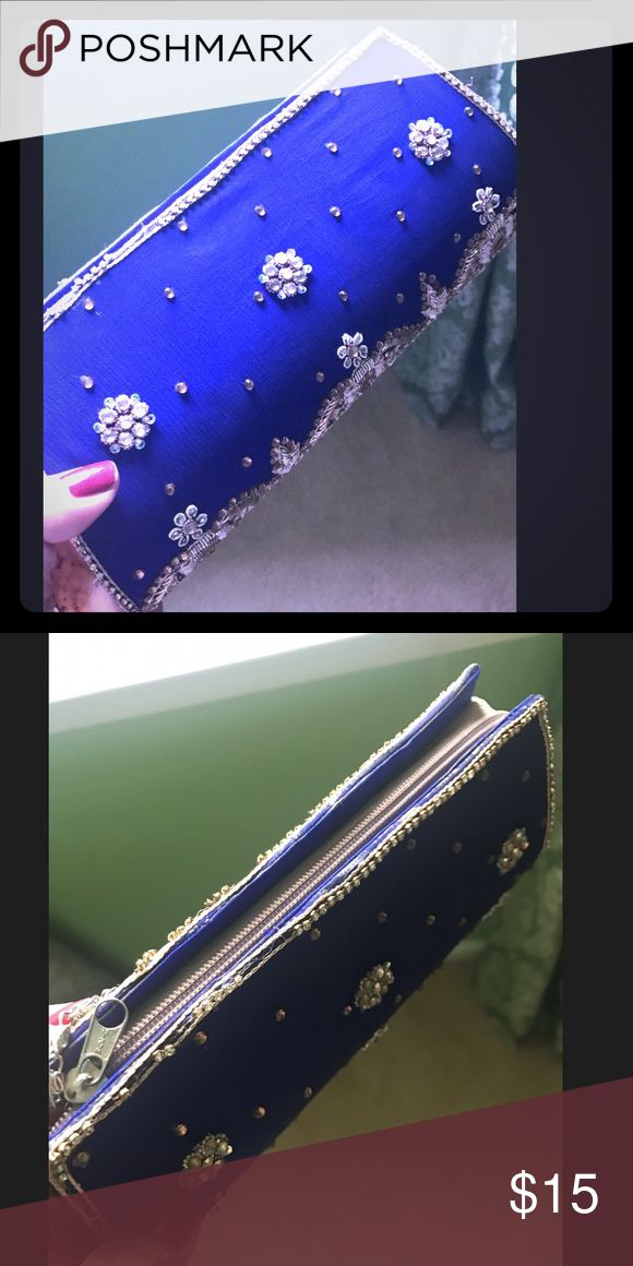 Blue clutch Blue clutch with beautiful gold work done on top. Perfect for weddings and parties Bags Clutches & Wristlets