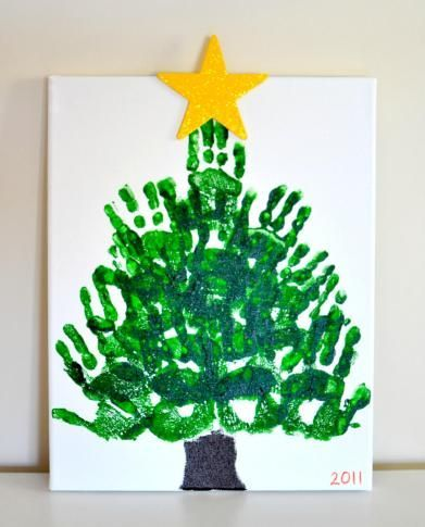 This handprint Christmas tree keepsake on canvas is my absolute favorite handprint craft we've ever made. What's