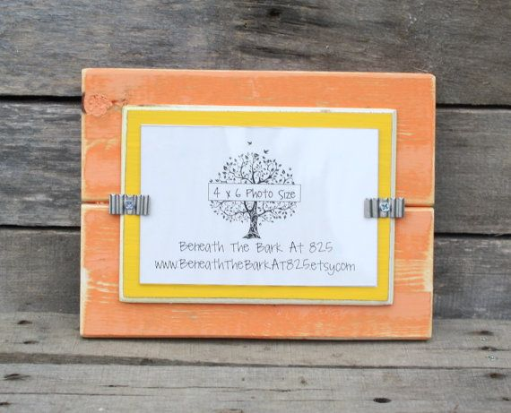 4x6 Picture Frame - Distressed Wood - Holds a 4x6 Photo - Tangerine Orange and Yellow This handmade picture frame holds a 4x6 photo. The distressed frame is painted tangerine orange with a yellow distressed mat. An acrylic photo cover is attached with silver corrugated metal