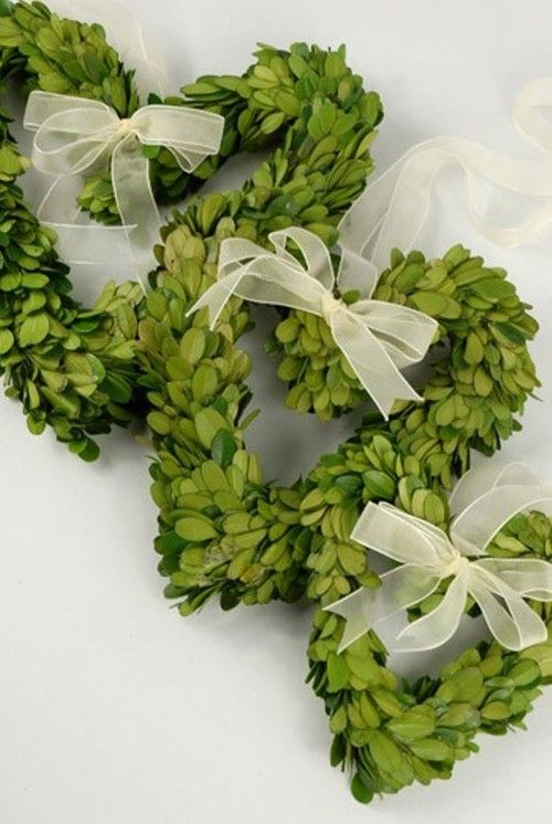 Love the boxwood ? Heart shaped wreaths to hang around the ceremony site . Possibly prettier, long, dainty ribbons .
