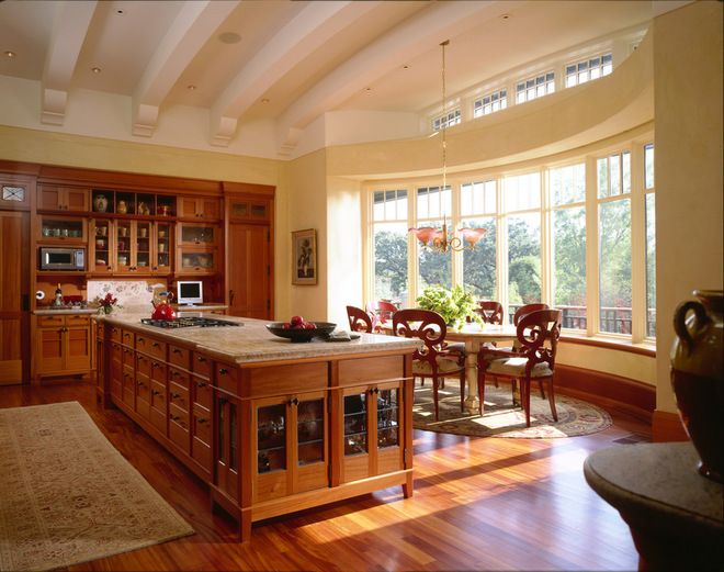 This large kitchen is great for entertaining! The large island and the huge bay window are ideal for keeping the host & hostess company while they're preparing the goodies. Traditional kitchen by TEA2 Architects.