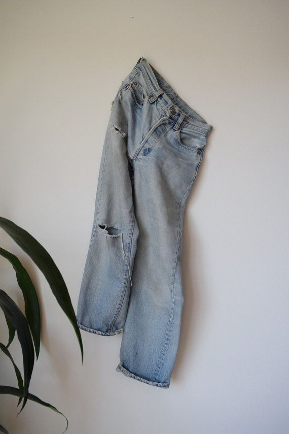 about //  vintage levis 501 marked size 27/34. these high waisted button front jeans have great character and have been lovingly worn in