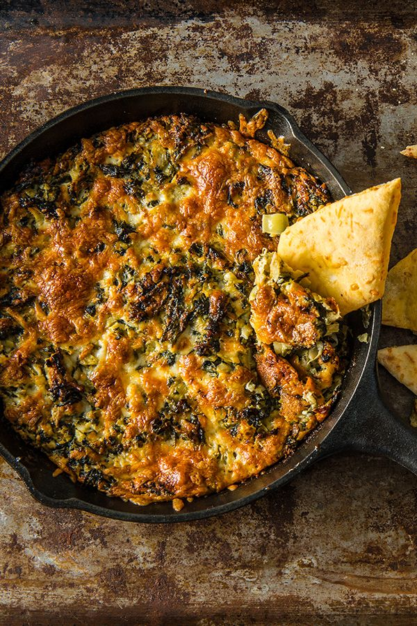 Baked Artichoke Dip with Homemade Flatbread. You'll flip over this wood-fired dip. Homemade flatbread is paired perfectly with a melty, cheesy, bubbly baked artichoke dip everyone will love. ⠀