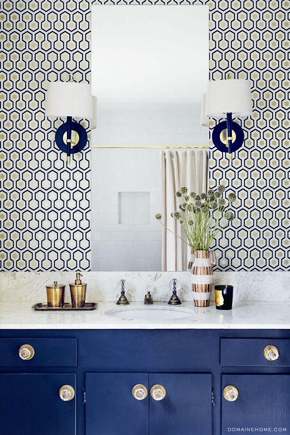 Exclusive: Tour Claire Thomas' Mod House on Stilts via @domainehome // Hicks wallpaper and Jonathan Adler sconces in guest bathroom.
