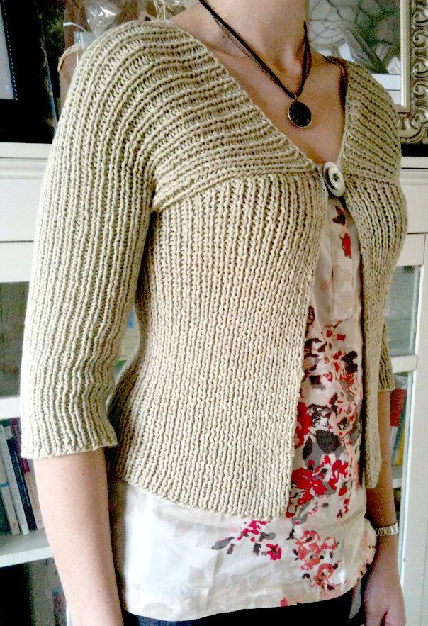 Free Knitting Pattern for Easy High Line Cardigan - Short sleeved cropped cardigan knit in K1, p1 rib and rated easy by Ravelrers. Sizes s, m, l, xl. Quick knit in bulky yarn. Designed by Rosemary Drysdale for Tahki Stacy Charles. Pictured project by drsmak