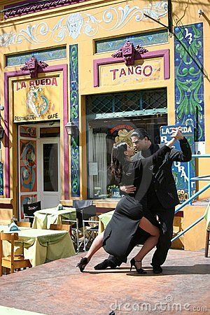 Tango Dancers in La Boca Buenos Aires Argentina. I'm thinking this is staged for the camera, but I do love the background which brings the dancers to life.