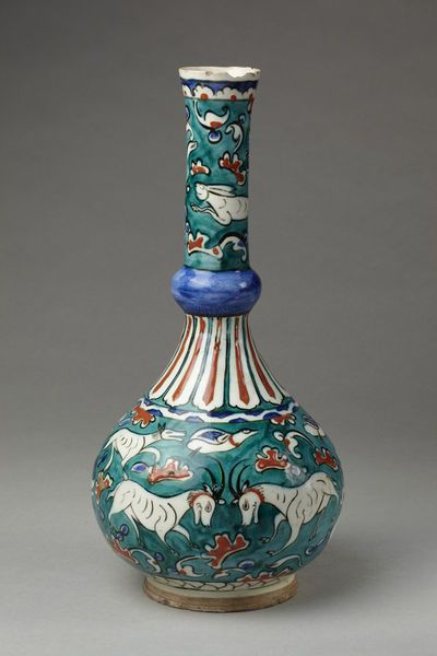 Bottle | Iznik, Turkey, ca. 1585 | Fritware, polychrome underglaze painted, glazed | Whitish-grey fritware, painted in colours and covered with a clear glaze | Bulbous body, long tubular neck expanding slightly at the mouth, with blue knop near the lower end. Body and upper part of neck are decorated with goats, hounds, hares and other animals. Below the neck is divided into long narrow shaped panels. Round the mouth is a border of cresting | VA Museum, London
