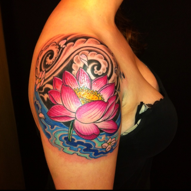 I'd love a lotus tattoo in this exact location one day. Same idea, different tattoo.