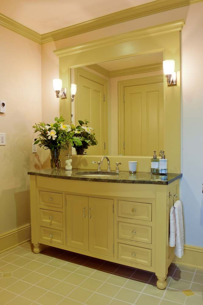 Custom Powder Room Vanity With Rounded Apron Front And Bun