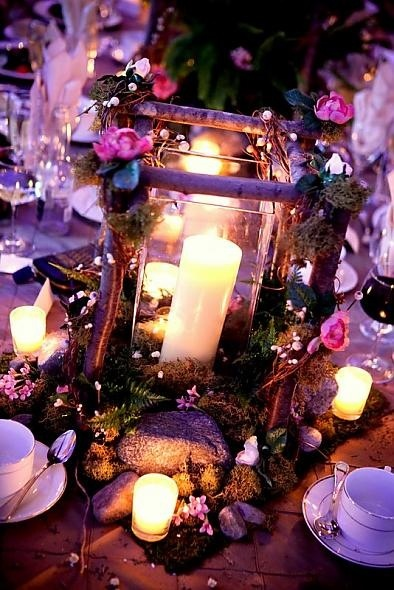 A Midsummer Night's dream- centerpiece: the sticks spraypainted white with white flowers!