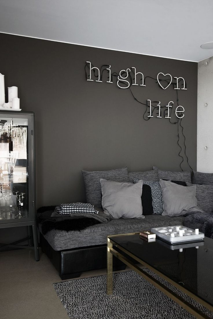 best 25 dark grey couches ideas on pinterest grey couch rooms a cozy little corner i love the sofa cabinet and neon i also like that no attempt was made to hide the cords for the neon light