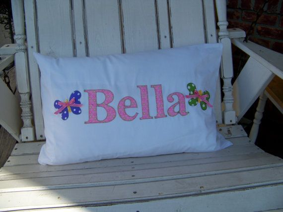 Personalized pillowcase embellished with her name and beautiful polka dotted butterflies. The perfect way to to adorn her room. A whimsical touch to add to an already cozy bed. This pillowcase will make her the envy of the sleepover for sure.  A great gift for...siblings, nieces, nephews. A perfect gift for the grands, too.  Please state the name and colors in the note to the seller window at checkout.  Be sure to check out the rest of my shop...Enjoy! http://www.etsy.com/shop/JamieDeLong
