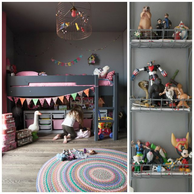 I love the colors in this girls room, the bright colored accessories with the dark walls and dark colored bunk beds make it look bright and airy!