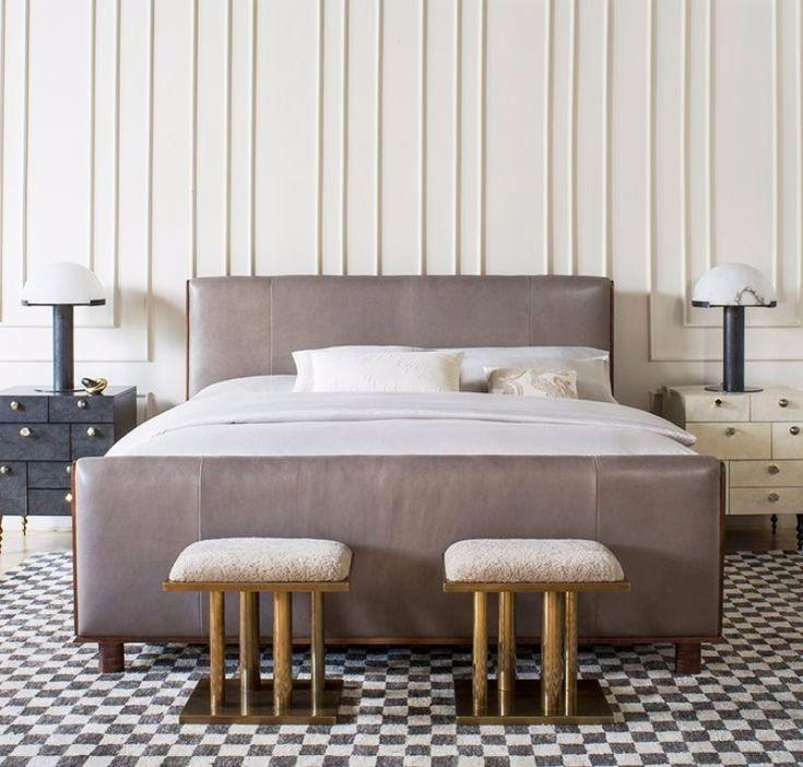 This gorgeous master bedroom design is the work of Kelly Hoppen. It's absolutely stunning with the mismatches nightstands, pair of golden detailed bedroom benches and magnificent bed.