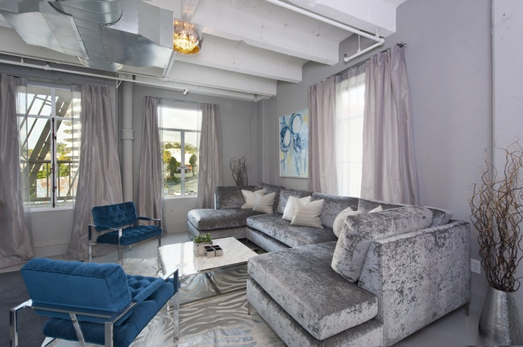 crushed velvet silver oversized lounge sofa, turquoise & metal side chairs, dusty lavender drapes......... be still my heart.