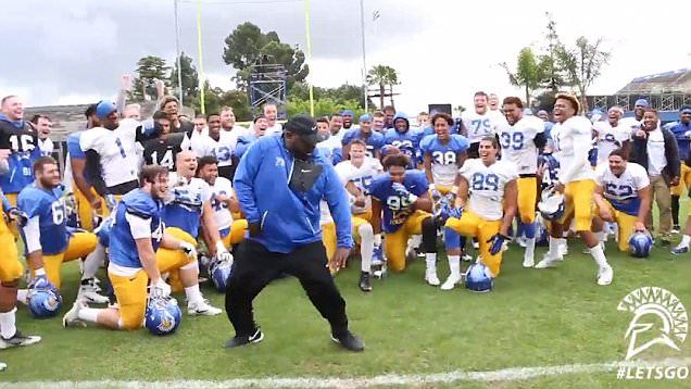 San Jose State University football coach and former MC Hammer backing dancer Alonzo Carter, showed off his dance moves in front of his team to the hit 'U Can't Touch This.'