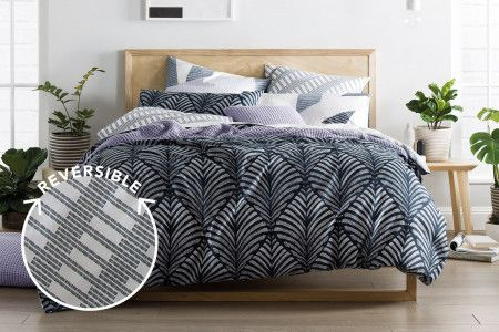 Sheridan Zofia reversible quilt cover - Midnight... nspired by summer palm fronds, Zofia is a graphic and contemporary bed. Fully reversible, we playfully mix and match prints with the bed reversing to a contrasting geometric design. Offered in both saturated or subtle tones and printed on soft 100% cotton sateen, Zofia is perfect for any bedroom space.