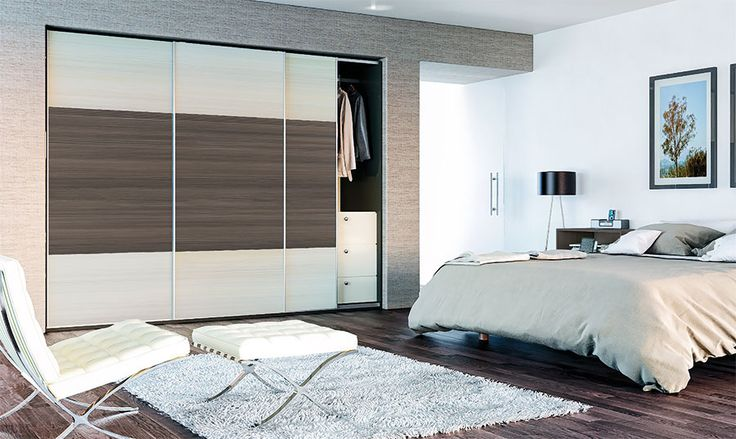 Glidor sliding wardrobe by BA Components. Cream and flint grey slide robe manufactured in the UK. Can be made to measure to fit your space, meaning it's a brilliant bedroom storage solution.