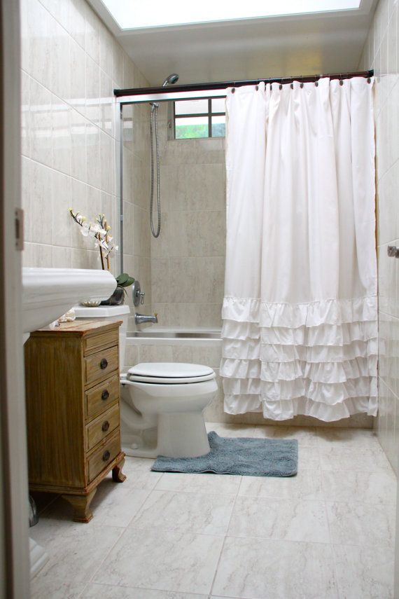 love the shower curtains with ruffles, cute for Katy's bath or guest!