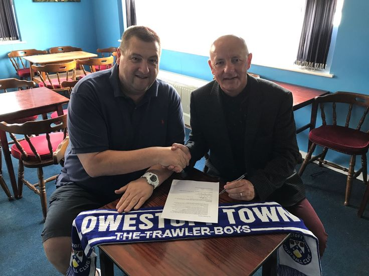 Gary Keyzor and Lord Russell Baker sign tge Griund Naming Rights deal between Lowestoft Town FC and Amber Dew Events.