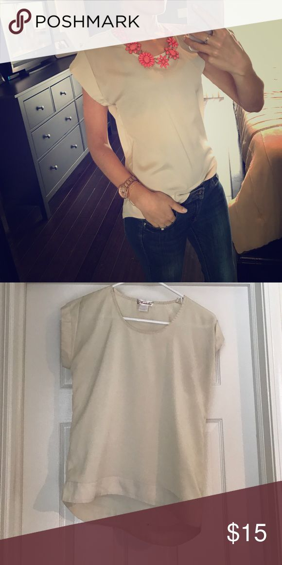 Cream short sleeve top Short sleeve cream top. Slightly longer in the back and rolled sleeves. It doesn't have a tag, but I think this is made from polyester. In good condition Annabelle Tops Blouses