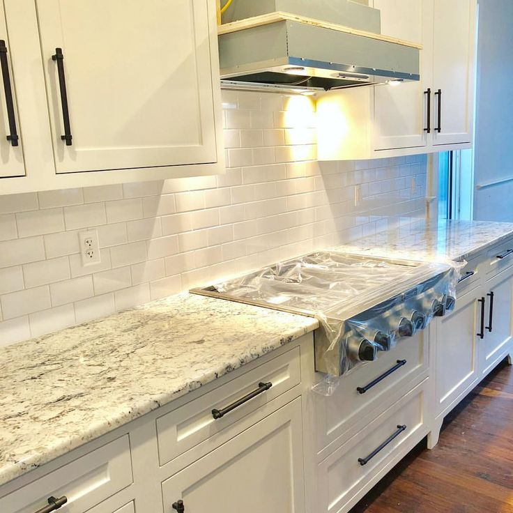 Kitchen is getting there! Shiny white subway tile …