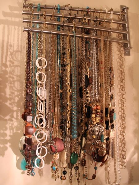 I like this way of organizing and displaying necklaces of all options I've seen pinned so far. Simple, no counter/dresser space required.
