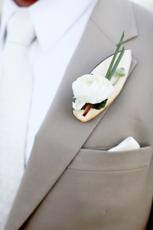 Surfboard boutonniere - perfect for a beach wedding