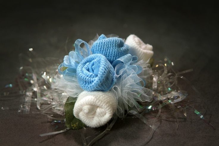 2 pair of baby socks make this cute baby shower corsage!! Add a pacifier for more cuteness.  $13.95 and up