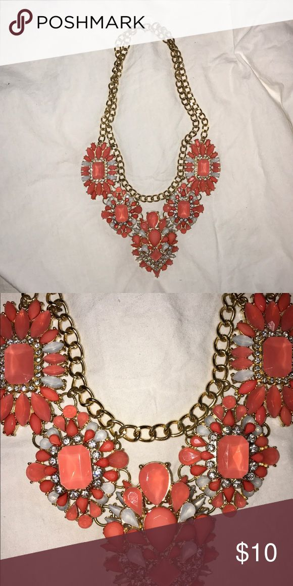 Coral Statement Necklace Coral and gold statement necklace from Charming Charlie. Only worn a few times and in perfect condition! No gems are missing. Charming Charlie Jewelry Necklaces