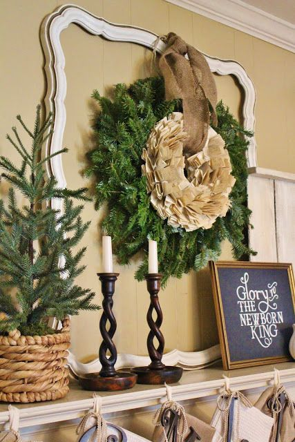 Hang wreaths from an empty frame on the mantle makes it easier to change the wreath out for each season