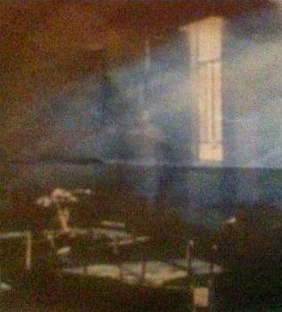This photograph was taken in 1998 at the Craig Dunain Mental Hospital located in Inverness, Scotland. The picture appears to show an apparition of a ghostly figure dressed in white standing in the corner of a room by a window. Local people of the area who are well aware of the history of the notoriously haunted building claim that the spectre is a former patient of the mental hospital.