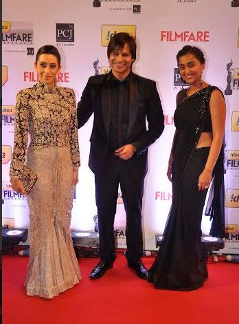 Karisma kapoor and vivek oberoi with his wife..