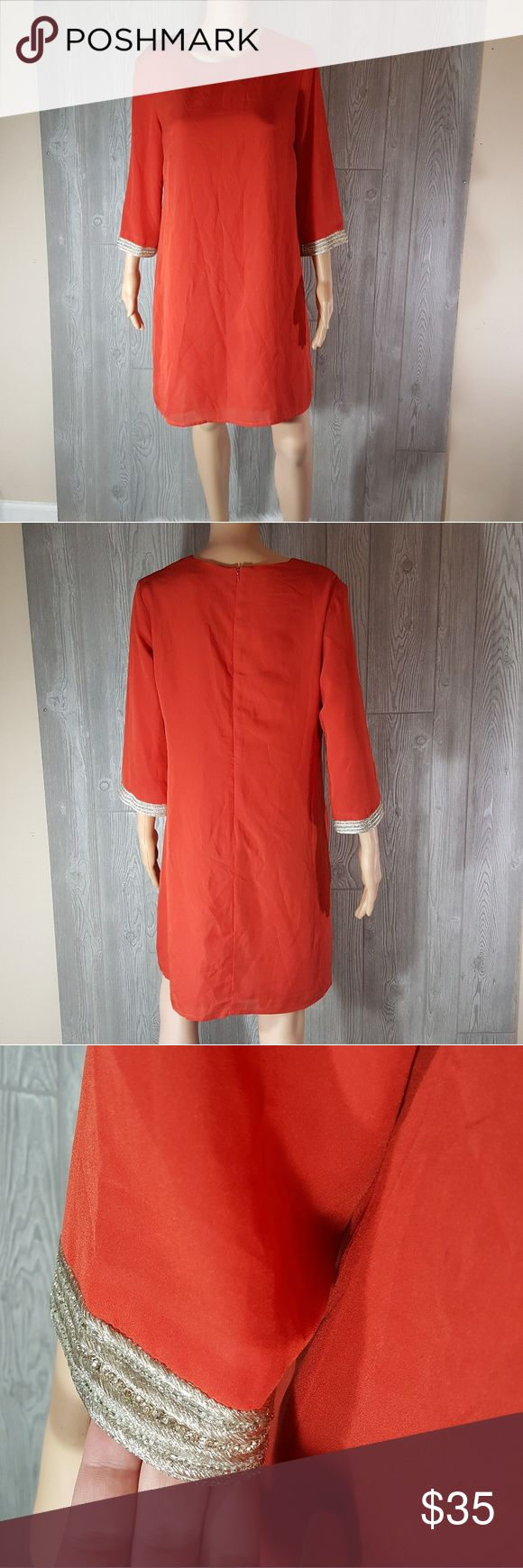 Med MM by Miss Me embellished  boho peasant dress Very pretty burnt orange dress with gold embelish on quarter sleeves. Size medium. Mm couture by miss me. Excellent condition. Small Mark pointing to and picture with sleeve measurement. Burnt orange meaning a reddish orange color MM Couture Dresses Midi