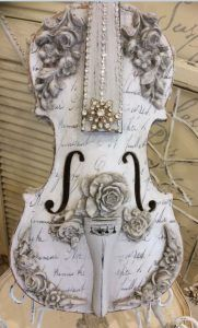 When you make my violin-shaped cigar box guitar complete with f-holes!  (I love the roses and design)