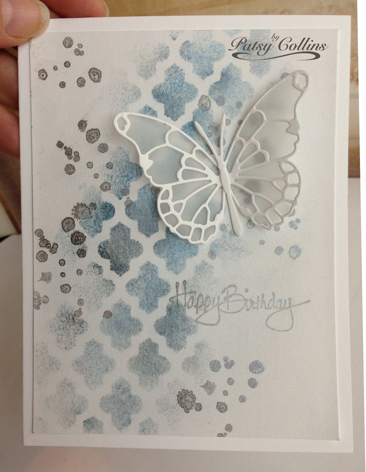"""By Patsy Collins. Lay """"Lattice"""" stencil (Heidi Swapp/Pink Paislee) on white cardstock. Ink through stencil with VersaMark. Lift stencil. With brush, apply Perfect Pearls. Spritz with water to activate bonding agent. Dry. Stamp sentiment and splots from Su """"French Foliage"""" in gray. Add Memory Box die-cut butterfly (""""Darla"""" cut from vellum; """"Vivienne"""" cut from white cardstock)."""