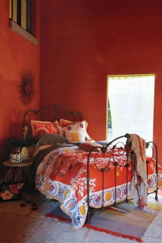 Orange you glad you saw this fabulous home decor pin? This super chic bedroom w/ Morrocan influences features vibrantly colored textiles, prints, & unique eclectic style.
