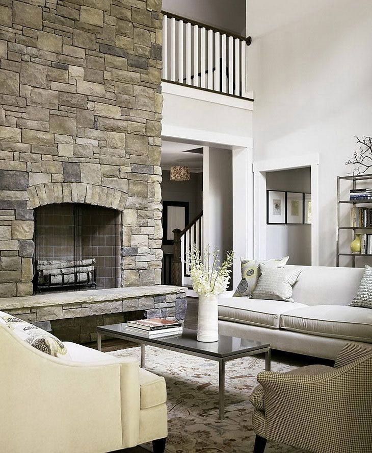 Living room with solid stone wall from a rock tiles for Wall tiles designs for living room