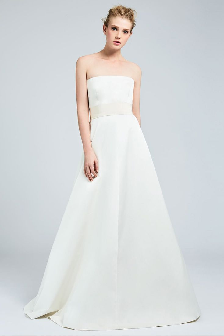 BAMBU, Milk-white corset dress in fine radzmir, with a full, slightly flared skirt and a gros-grain waist belt with a bow at the back. Hip pockets and the pure, minimalist lines uncover a modern romanticism completed by couture features. #MaxMaraBridal #weddingdress #abitodasposa