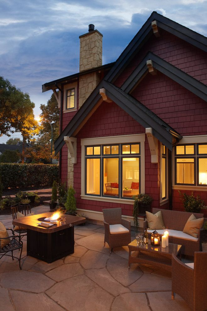 superb Red House Patio Traditional design ideas with black trim coach house color scheme cream trim firepit flagstone gables hedge