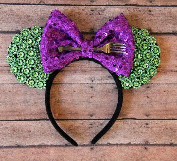Show off your Disney side in this Under the Sea inspired Ariel Disney Ears. Features a purple bow with sequence detailing adorned with a fork and a sea