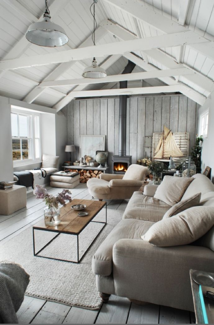 Light grays and white... love the exposed beams and wide plank flooring in this barn style space.