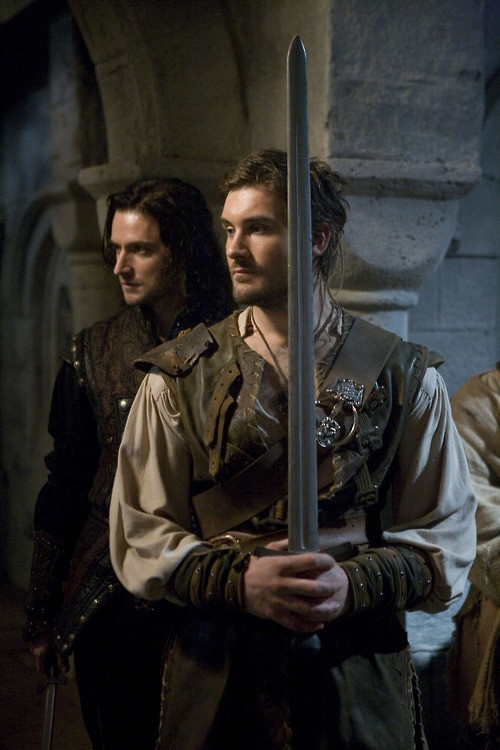 Richard Armitage as Guy of Gisborne and Clive Standen as Archer