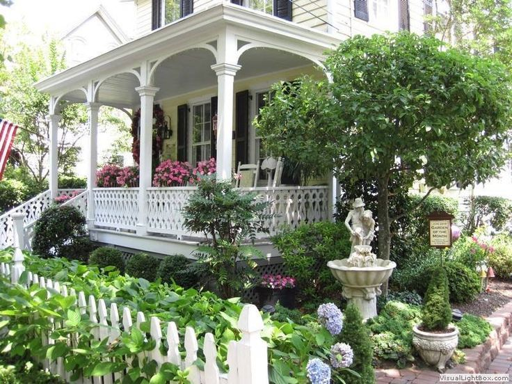 adorable white victorian with enchanting