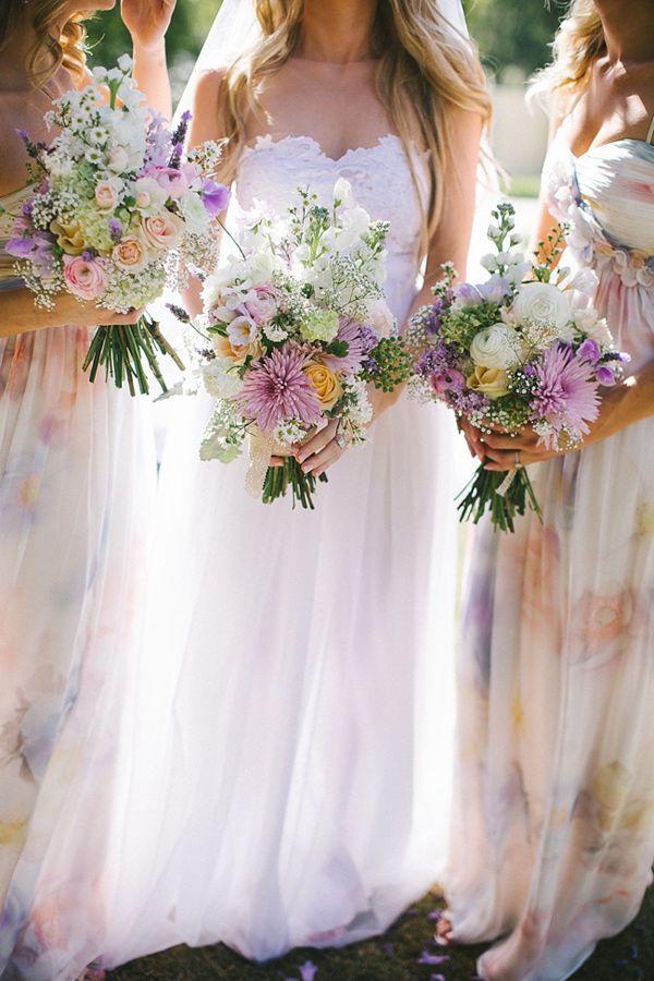 Fresh, trendy Lavender + Peach watercolor bridesmaids gowns.