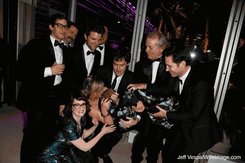 Andy Samberg, Nick Offerman, Adam Scott, Megan Mullally, Brian Doyle Murray, Bill Hader, Amy Poehler (performing handstand), Bill Murray, and Paul Rudd attend the 2014 Vanity Fair Oscar Party Hosted By Graydon Carter on March 2, 2014 in West Hollywood, California.