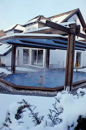 Sliding roof/pool cover.   The cover slides up and down and doubles as a roof/pool cover