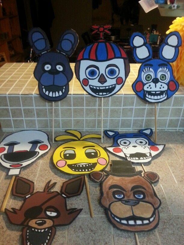 Justin's fnaf birthday party photo booth masks.